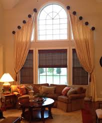 love this a two story living room requires a dramatic window a two story living room requires a dramatic window treatment medallions mounted