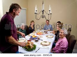 traditional thanksgiving in the usa with family preparing