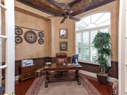 traditional home office with chair rail u0026 hardwood floors in