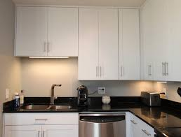 Contemporary Kitchen Cabinet Hardware White Contemporary Kitchen With Brushed Nickel Hardware And Black