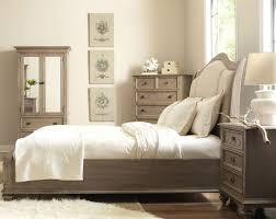 king upholstered sleigh headboard bed with nail head trim by