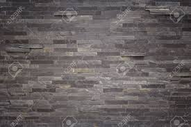 pattern of black slate wall texture and background stock photo