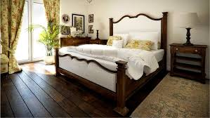bedrooms with hardwood floors and area rugs wood door