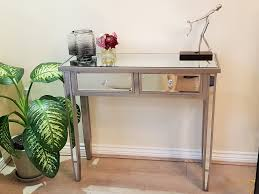 wood and mirrored console table mirrored console table with chagne wooden trim and mirrored legs