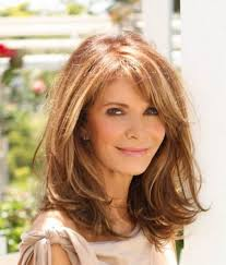 hairstyles for women over 50 with elongated face and square jaw long haircut layered with bangs long hairstyles for women over 50