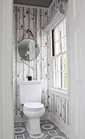water closet with wainscoting and wallpaper by vanessa francis