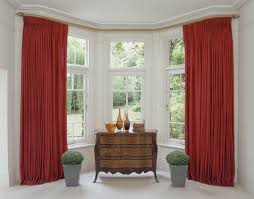 silent gliss 50mm hand operated metropole in oak to fit a two bend bay with returns bay window curtainsgold