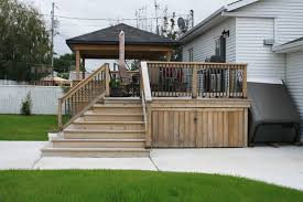 tasty enclosed patio under deck painting stair railings with