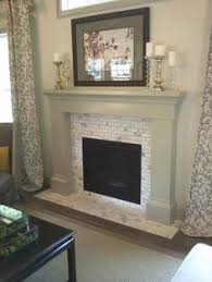 Mosaic Tile Fireplace Surround by Living In High Gloss Tiling The Fireplace Surround Glass Tile