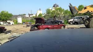 car junkyard michigan smashing a car at the junk yard youtube