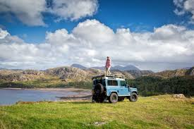land rover overland camping on the mountains of scotland with a land rover defender