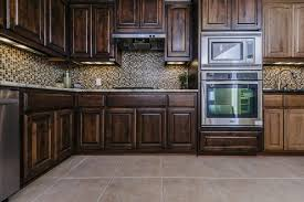 do you tile under kitchen cabinets modern kitchen awesome kitchen design with l shape brown wooden