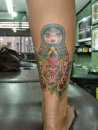 anchor eye matryoshka tattoo on biceps in 2017 real photo