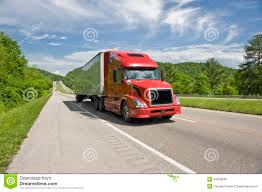 red semi truck on interstate in springtime stock photo image