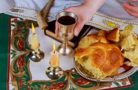 sabbath candles a table set for shabbat with lighted candles challah bread and