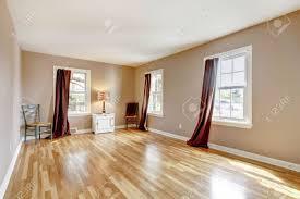 beautiul empty bedroom with three windows and hardwood floor beautiul empty bedroom with three windows and hardwood floor stock photo 13888930