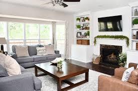 family room makeover with white built ins and charcoal couches