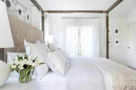 gray canopy bed with seagrass headboard transitional bedroom