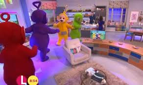 lorraine kelly appears grabbed chest teletubby tv