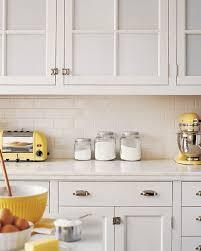 antique white kitchen cabinets with subway tile backsplash white subway tile traditional kitchen martha stewart