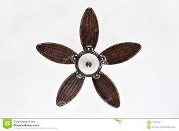 pretty brown wicker ceiling fan against background stock