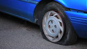 flat tire on blue car stock footage video 949258 shutterstock