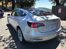 tesla model 3 rear three quarters left side spy shot indian