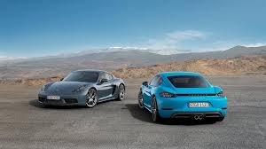 teal porsche porsche debuts new 718 cayman sports coupes with carplay support