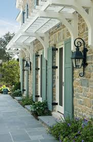 Mediterranean Wall Sconces Cool Touch Exterior Exterior Traditional With Trellis