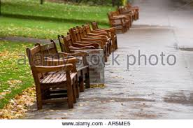 Benches In Park - benches in a row in princes street gardens edinburgh stock photo