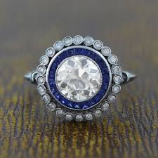 art deco style engagement ring sapphire and diamond halo