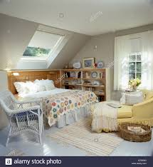 Attic Bedroom by Traditional Attic Bedroom With Yellow Chaiselongue And Patchwork
