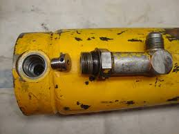case 580 ck swing cylinder flow restrictor