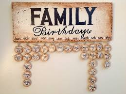 family birthdays wooden plaque with 30 disks and ribbons