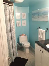 bathroom white closet on floortile under small pictures on soft