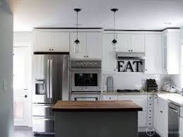 white kitchen cabinets with white appliances ikea stainless steel