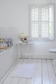 white wood spaces lights and bath ideas