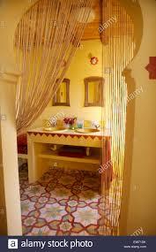 bead curtain on moorish style arched doorway to yellow spanish