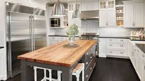espresso kitchen cabinets with white quartz countertops choosing the best countertops for your home