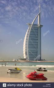 The Burj Al Arab Jet Skis On Umm Suqeim Public Beach In Dubai With The Burj Al Arab