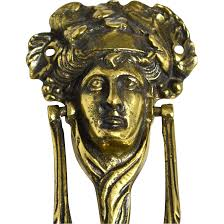 antique english brass bacchus or dionysus figural doorknocker from