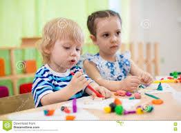 kids doing arts and crafts children in kindergarten stock photo