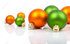 multi colored ornaments orange and green on a white