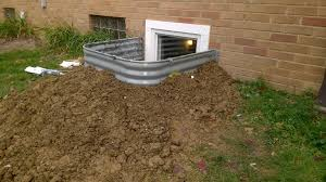 how far does a basement egress window well need to stick out above