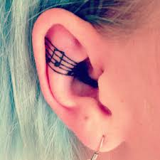 music notes tattoo in ear photos pictures and sketches