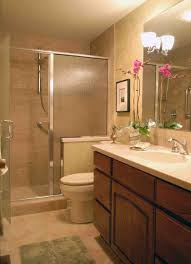 small bathroom decorative storage above toulet decorating use oak vanity and closed shower space completing small bathroom remodel ideas with clear wall mirror