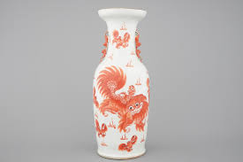 orange foo dogs a iron porcelain vase with foo dogs 19th c rob