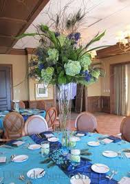 Feather And Flower Centerpieces by Peacock Centerpieces Peacock Centerpiece At Our Reception Photo