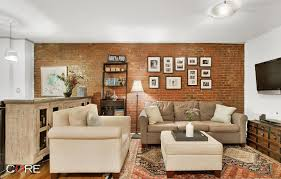 exposed brick dominates at this 979k duplex on the upper west
