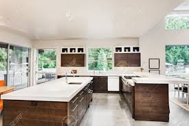 kitchen with island sink cabinets and view of trees stock photo
